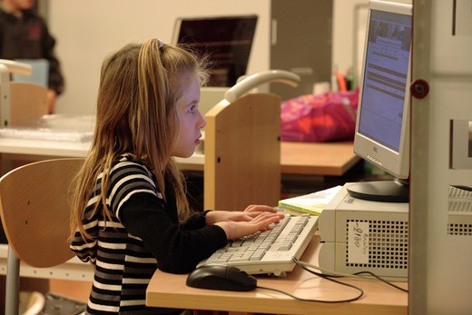 Stock Photo: 4252-3975 Little girl computer library