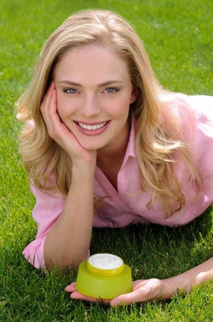 Stock Photo: 4252-567 Woman moisturizing cream.