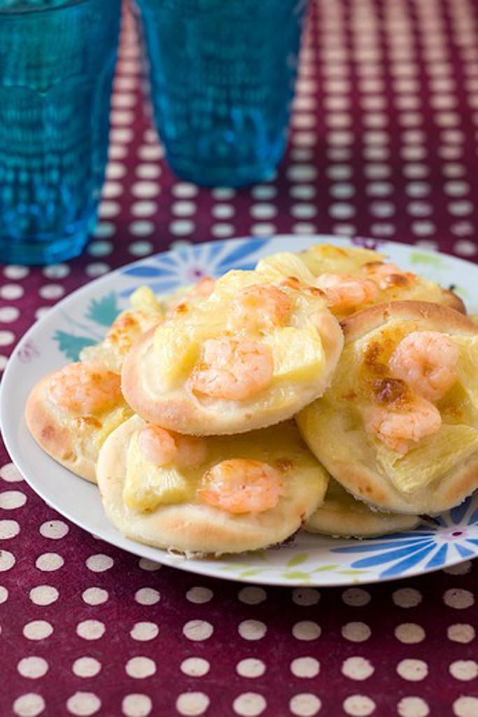 Stock Photo: 4252-7375 Pineapple shrimp pizzettes