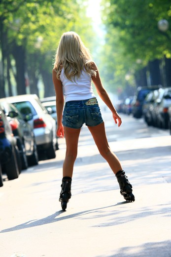 Stock Photo: 4252-7728 Woman rollerblade