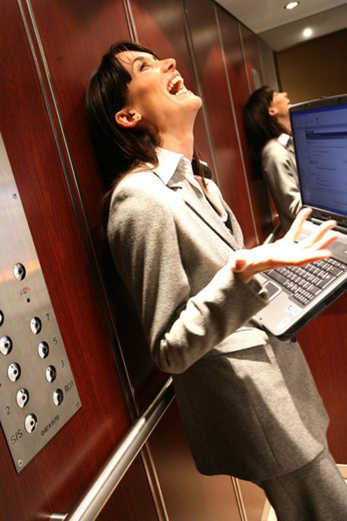 Woman work elevator : Stock Photo