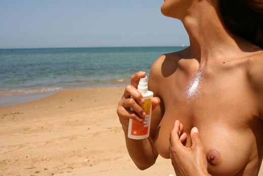 Stock Photo: 4252-8163 Woman beach and sunscreen cream