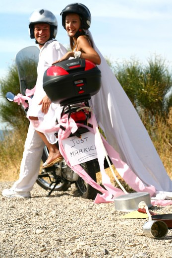 Stock Photo: 4252-8302 New wed couple scooter