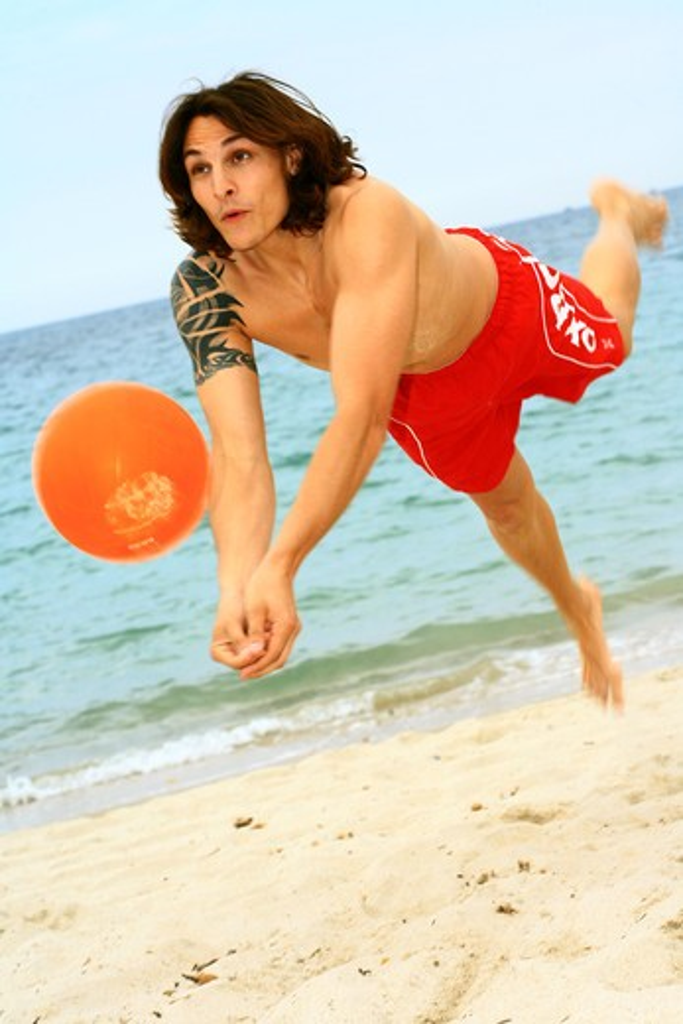 Stock Photo: 4252-8502 Man beach volley