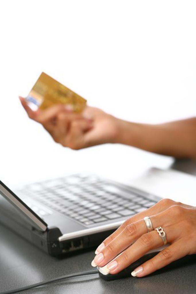 Stock Photo: 4252-9256 Woman e-buying