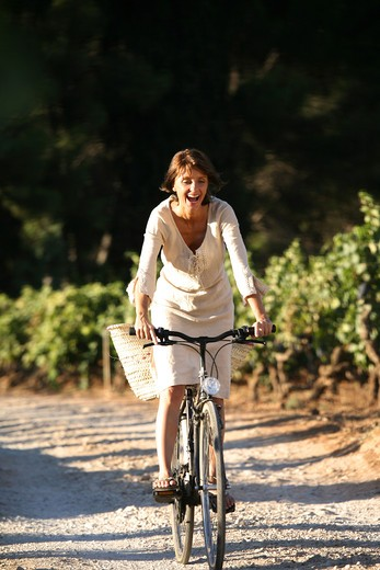 Stock Photo: 4252-9452 Woman bike