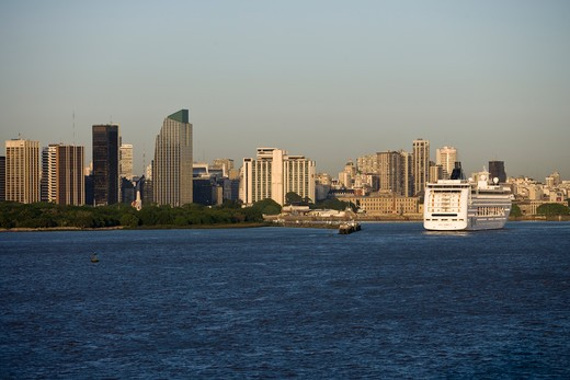 City skyline with cruiseship MSC Lirica (MSC Cruises) as it approaches pier,Buenos Aires, Buenos Aires, Argentina, South America : Stock Photo