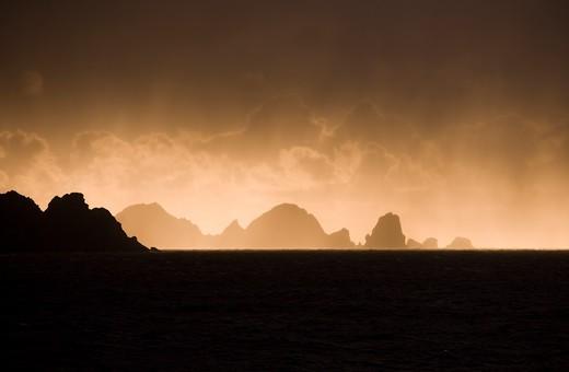 Stock Photo: 4256-1039 Rocky coastline at sunrise,near Cape Horn, Isla Hornos, Magallanes y de la Antartica Chilena, Patagonia, Chile, South America