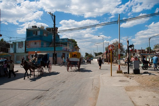 Horse carriages and train at intersection,Bayamo, Granma, Cuba, Caribbean : Stock Photo