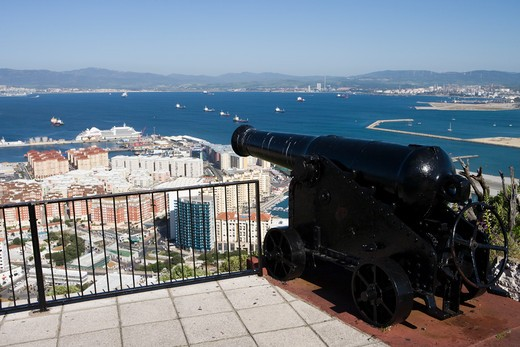 Cannon at a lookout point with city and Mediterranean Sea in backgorund,Gibraltar,Gibraltar, Europe : Stock Photo