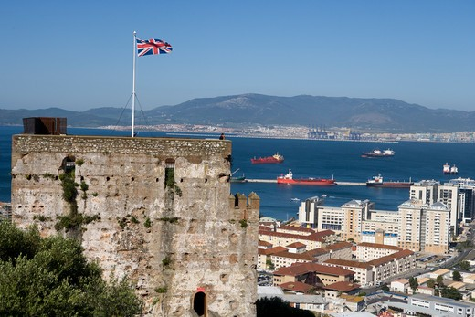 Union Jack British flag fluttering fromMoorish fort tower with overhead of city, Gibraltar, Gibraltar, Europe : Stock Photo