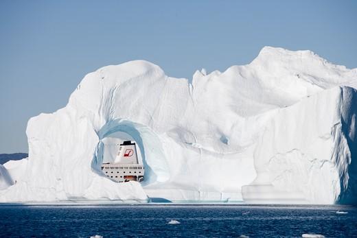 Stock Photo: 4256-1245 Cruise ship MS Deutschland (Reederei Peter Deilmann) seen through hole in iceberg from Ilulissat Kangerlua Icefjord,Ilulissat (Jakobshavn), Disko Bay, Kitaa, Greenland, Europe