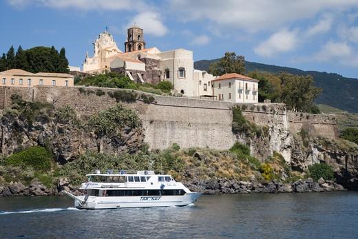Tourist excursion boat and Lipari town,Lipari, Aeolian Islands, near Sicily, Italy, Europe : Stock Photo