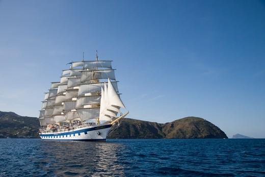 Stock Photo: 4256-1255 Sailing cruise ship Royal Clipper (Star Clippers Cruises) under full sail,Mediterranean Sea, near Lipari, Aeolian Islands, near Sicily, Italy, Europe
