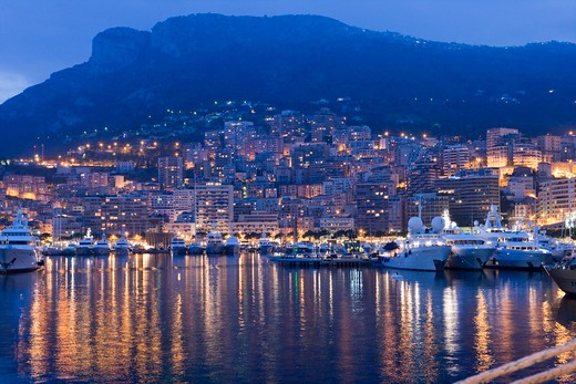 Stock Photo: 4256-1283 Luxury yachts in harbor and Monaco city lights, Monte Carlo, Monaco, Europe
