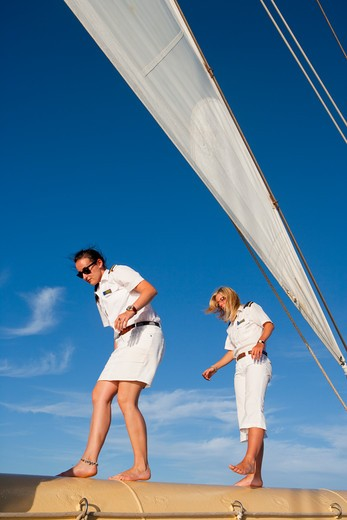 Crew walk on bowsprit of sailing cruise ship Star Flyer (Star Clippers Cruises), Mediterranean Sea, near Bastia, Corsica, France, Europe : Stock Photo