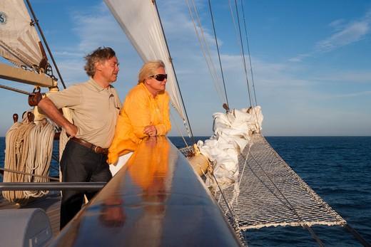 Stock Photo: 4256-1298 Couple at railing of sailing cruise ship Star Flyer (Star Clippers Cruises), Mediterranean Sea, near Bastia, Corsica, France, Europe