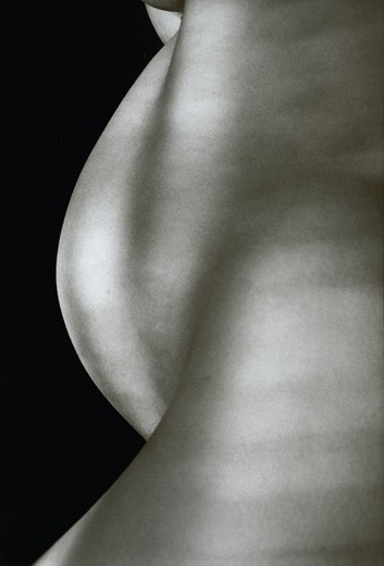 Pregnant woman's tummy and thighs in profile : Stock Photo