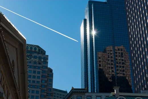 USA, Massachusetts, Boston, vapor trail over city : Stock Photo