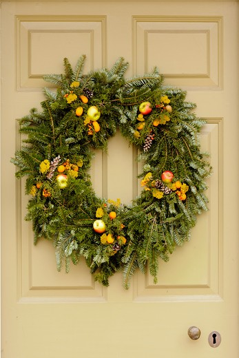 Handmade Christmas decorated wreaths hanging from a door, Williamsburg, Virginia, USA : Stock Photo