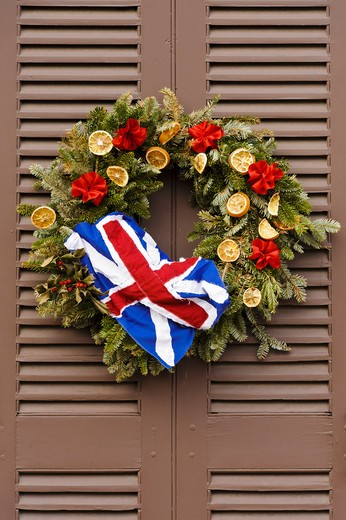 Stock Photo: 4260-1398 Handmade Christmas decorated wreaths hanging from a door, Williamsburg, Virginia, USA