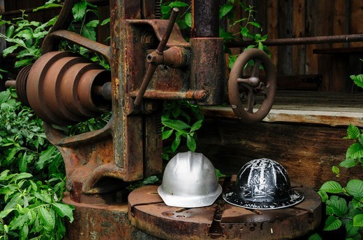 Stock Photo: 4260-1759 Hardhats and old rusted mining equipment, Alaska, USA