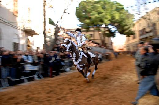 Stock Photo: 4261-45228 Horseman gallops to pierce the star with his sword, Sartiglia feast, Oristano, Sardinia, Italy