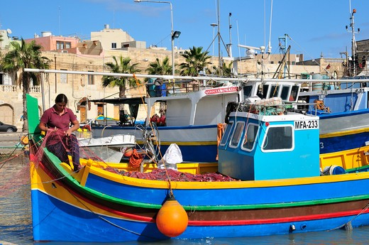 Woman at work on Luzzo traditional fishing boat, Marsaxlokk, Malta, Europe : Stock Photo