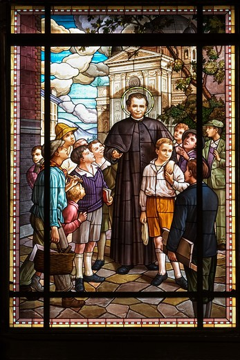Stained glass windows portraying San Giovanni Bosco with his children, Lower Church, San Giovanni Bosco sanctuary, Castelnuovo Don Bosco, Piedmont, Italy : Stock Photo