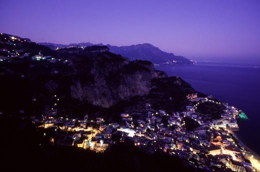 Amalfi, Amalfi coast, Sorrento, Italy:  night view over Amalfi and up on the hill, Ravello : Stock Photo