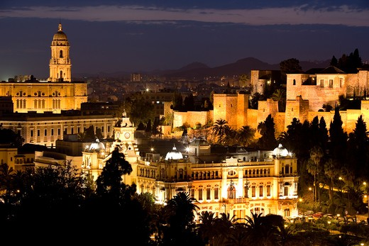 Costa del Sol, Malaga: night view over the Ajuntamiento, the Alcazaba and part of the old walls of the Gibralfaro castle. In the distance, the Cathedral, Spain, Europe : Stock Photo