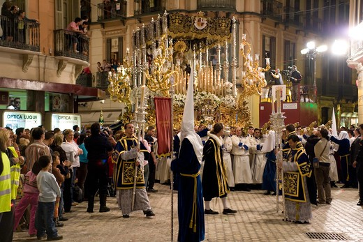 Costa del Sol, Malaga: Easter Week, members of the cofradia carrying the heavy floats during the night procession of the holy friday, Spain, Europa  : Stock Photo