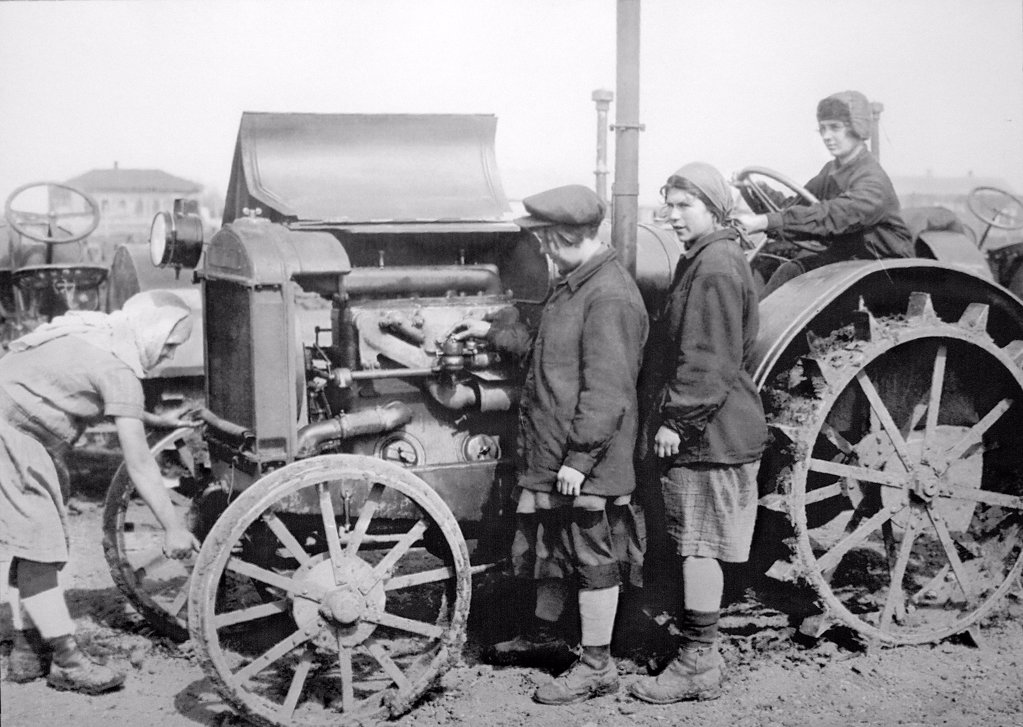 Tractor drivers at the tractor 'International' by Anonymous  /State Museum of the Political History of Russia, St. Petersburg/1929/Photograph/Russia/Genre,History : Stock Photo