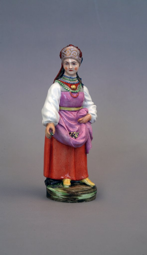 Sculpture of woman in traditional clothing by Jacques-Dominique Rachette, Porcelain, overglaze decoration, 1780-1790, 1744-1809, Russia, St. Petersburg, State Open-air Museum Peterhof : Stock Photo