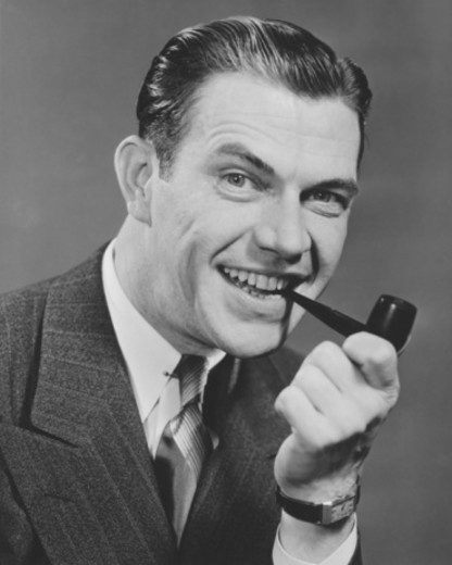 Stock Photo: 4267R-1132 Elegant man with pipe posing in studio, (B&W), close-up, portrait
