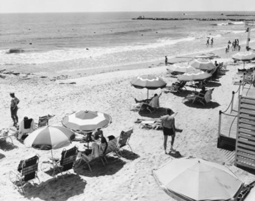 Stock Photo: 4267R-1734 People sunbathing at beach, (B&W)