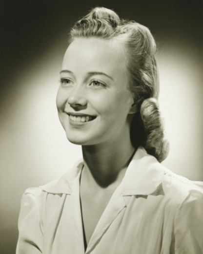 Smiling woman posing in studio, (B&W), portrait : Stock Photo
