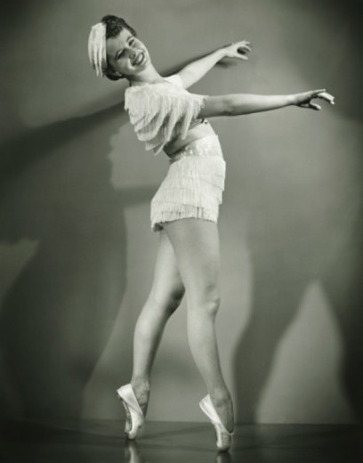 Stock Photo: 4267R-2333 Chorus girl dancing in studio, (B&W)