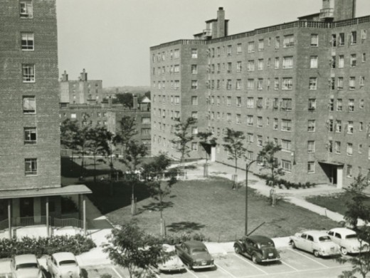 Stock Photo: 4267R-2398 Apartment buildings, court and cars on parking, (B&W), elevated view