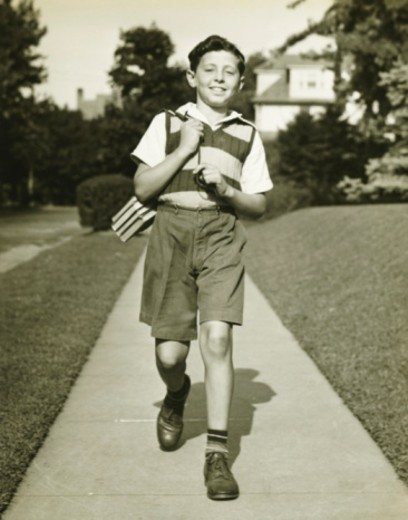 Stock Photo: 4267R-2584 Teenage boy (13-14) going to school, suburbs, (B&W)