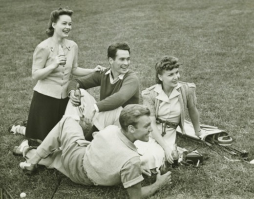 Stock Photo: 4267R-2601 Two couples having break after golf, (B&W),