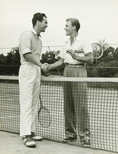 Stock Photo: 4267R-2602 Two tennis players shaking hand after match, (B&W)
