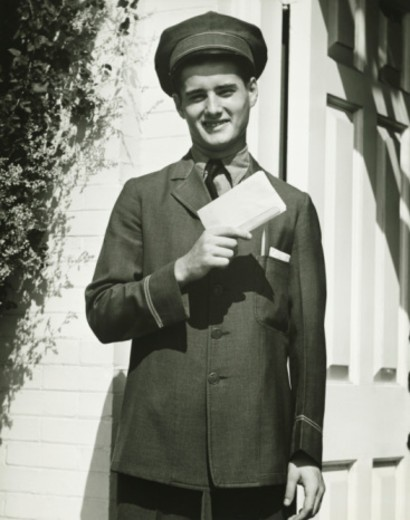 Mailman holding blank form outdoors, (B&W), portrait : Stock Photo