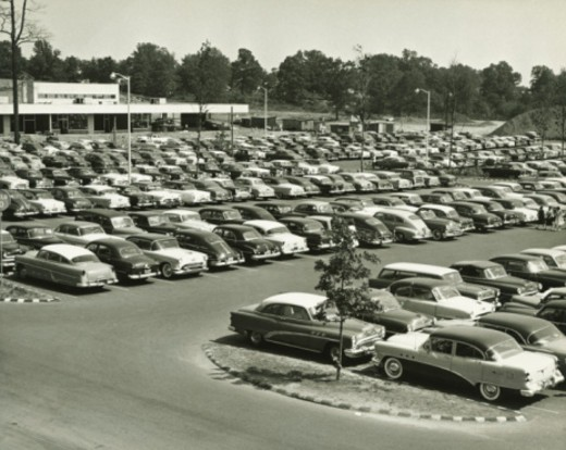 Cars parked on lot at shopping centre, elevated view (B&W) : Stock Photo