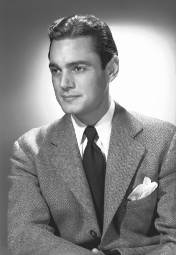 Stock Photo: 4267R-2959 Elegant man posing in studio, (B&W), portrait