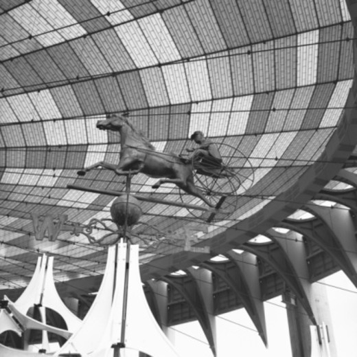 Sculpture of chariot under glazed roof, (B&W), low angle view : Stock Photo