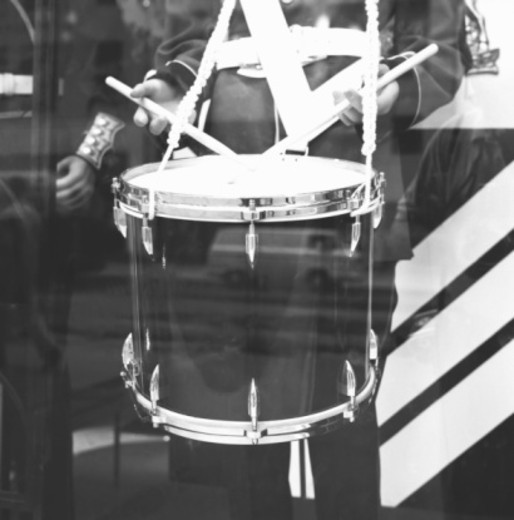 Stock Photo: 4267R-3421 Military band drummer, reflection in window, (B&W), (mid section)