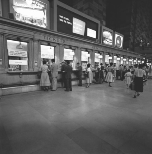 Stock Photo: 4267R-3721 People at ticket counters, (B&W)