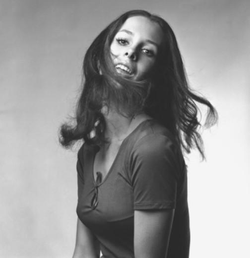 Young woman shaking head in studio, (B&W), portrait : Stock Photo