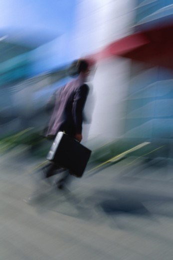 Blurred figure walking : Stock Photo